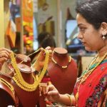 A woman baying a jewelary in jewelary shop